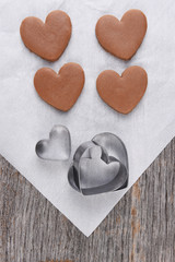 Four heart shape cookies on parchnment paper