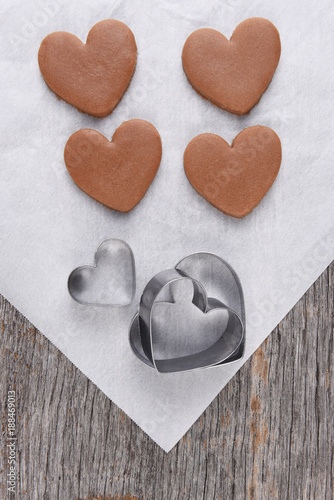 Four heart shape cookies on parchnment paper