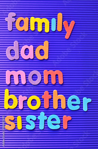 Leinwandbild Motiv The words family, dad, mom, brother and sister on a blue background