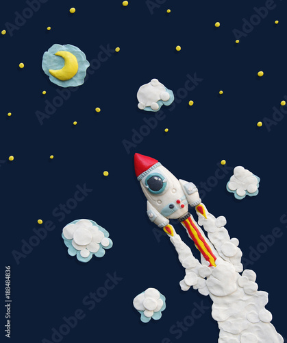 Plasticine white rocket in space with moon and star