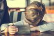 Small boy watching cartoons on smart phone.