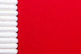 Menstruation, protection means. Row of white tampons on red background - 188501208