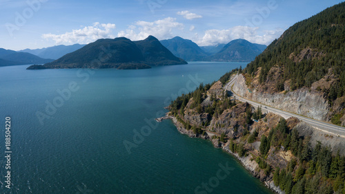 Foto Spatwand Canada Aerial view of Sea to Sky Highway in Howe Sound during a vibrant sunny summer day. Taken North of Vancouver, BC, Canada.