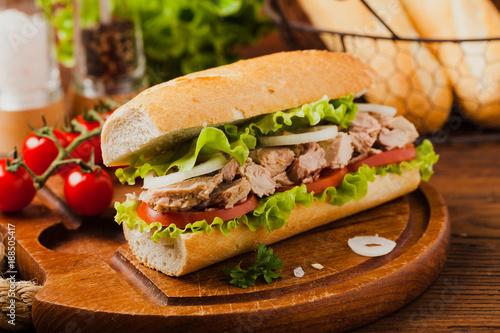 Delicious tuna sandwich, served with lettuce, tomato and onion. - 188505417