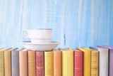 reading, learning, education: Old books and a coffee cup, close up, good copy space