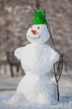 Fun snowman in park.