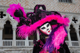 Cat costume - Female Venetian Mask in pink / black elegant costume on St. Mark's Square in Venice with traditional venetian pillar - Venice Carnival - 188523844
