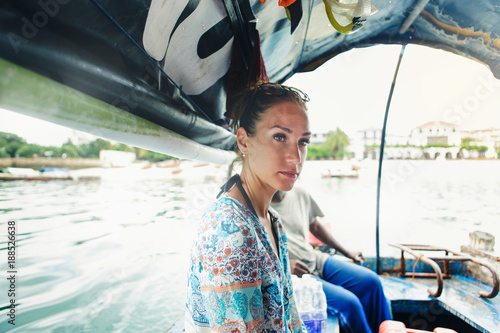 Foto Murales Female traveler in a boat is traveling. Travel lifestyle