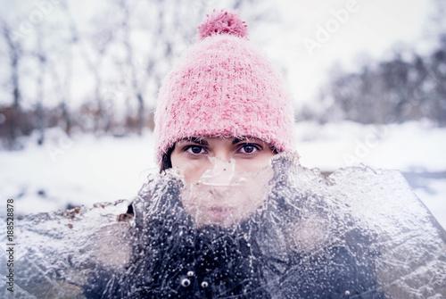 Fototapeta Woman looks through ice plate.