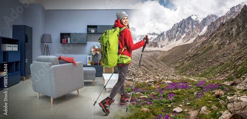 young sportswoman with backpack and hiking equipment dreaming about hiking in mountains