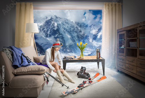 young skier wearing warm socks and dreaming about snowy mountains, ski equipment lying on floor