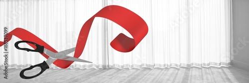 Foto Murales Scissors cutting ribbon with office window