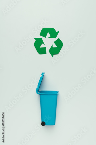 top view of recycle sign and garbage bin isolated on grey