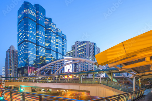 The beautiful cityscape on the skywalk of Train station at Bangkok, Thailand in blue hour.