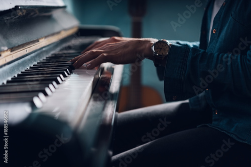Woman seated at a piano playing music