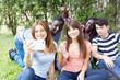 Multi ethnic teenagers friends happy making selfie outdoor