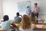 Teenager interviewed by teacher in the classroom