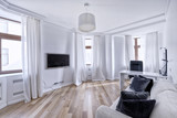 The interior of the spacious apartment in white tones. - 188548252