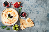 Homemade hummus with paprika, olive oil. Middle Eastern traditional and authentic arab cuisine. Meze party food. Top view, flat lay, overhead - 188553437