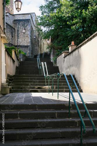 Fridge magnet staircase on street in Gien town in summer
