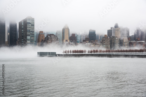 Canvas New York A dense fog covered New York City during the winter's day on January of 2018. View of Manhattan and Roosevelt Island.