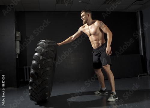 Fridge magnet Crossfit training - man flipping tire