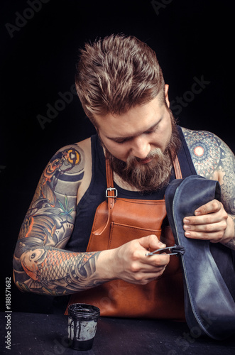 Foto Murales Leather Worker creating a new leather product