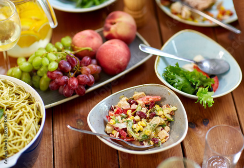 Poster salad, fruits and pasta on wooden table