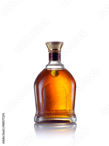 close up view of whiskey bottle on white back.