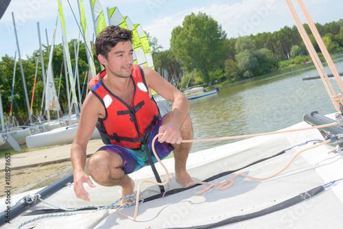 Fotobehang Zeilen young man going sailing