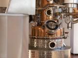 alembic still for making alcohol inside distillery, destilling spirits - 188580053