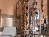 alembic still for making alcohol inside distillery, destilling spirits - 188580085