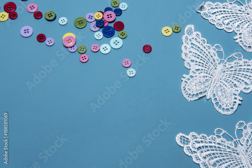 Foto Murales Arts and crafts background image of colourful buttons and lace butterflies, taken with copy space