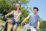 outdoor portrait of teenage couple riding bicycles in nature - 188582433
