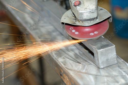 sanding a metal girder
