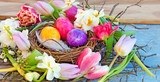 Fototapety Happy Easter: nest with Easter eggs, feathers, tulips and daffodils:)