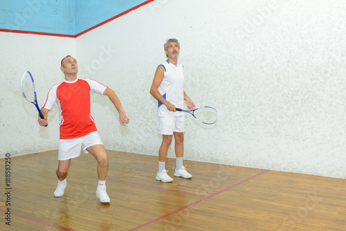 Fototapeta two men playing tennis indoors