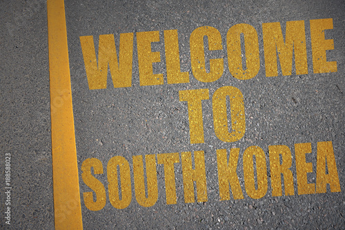Keuken foto achterwand Seoel asphalt road with text welcome to south korea near yellow line. concept