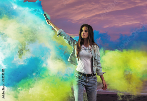 Aluminium Konrad B. Portrait of a sensual woman making colorful smoke
