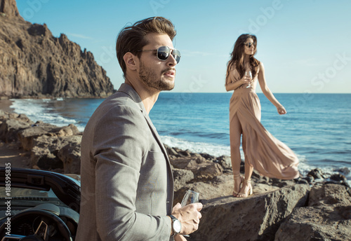 Foto op Canvas Artist KB Smart couple relaxing by the sea