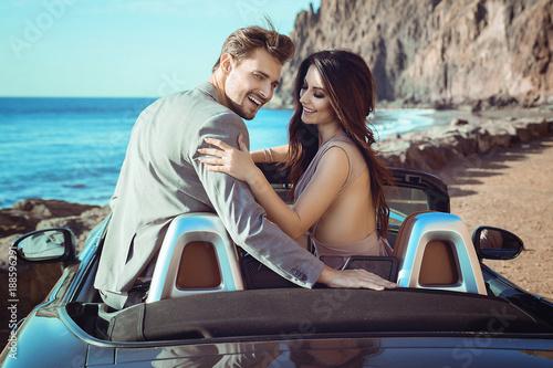 Foto op Canvas Artist KB Smart couple riding a luxurious convertible