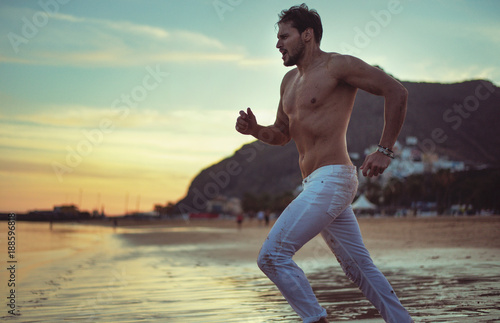 Foto op Canvas Artist KB Handsome guy running along the seaside