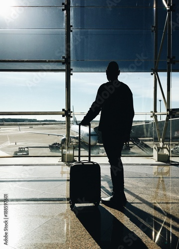man walking a airplane on an airport - 188597601