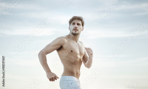 Papiers peints Artiste KB Portrait of a running handsome athlete
