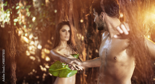 Fotobehang Konrad B. Portrait of two nude lovers walking among tropical trees