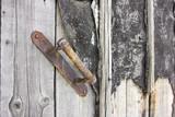 Antique door handle on a wooden door. Old Wood Texture - 188598406