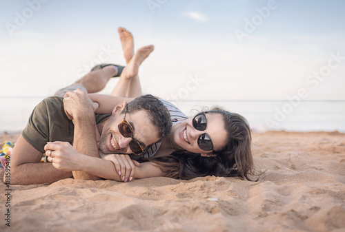 Fotobehang Konrad B. Portrait of a cheerful couple resting on vacation