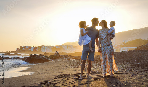Foto op Canvas Artist KB Cheerful family on vacation, beach walk