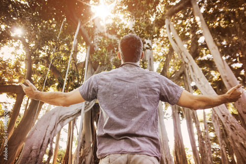 Foto op Canvas Artist KB Relaxed man enjoying summer time in a tropical forest