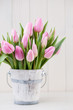 Spring easter tulips in bucket on white vintage background. - 188609861